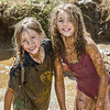"Nine-year-olds Rosie Paris, left, and Abby Conklin had a good time playing in the pit during Mud Day in the Georgeon Botanical Garden, sponsored by UAF's School of Natural Resources and Extension.  <div class=""ss-paypal-button"">Filename: LIF-14-4212-60.jpg</div><div class=""ss-paypal-button-end""></div>"