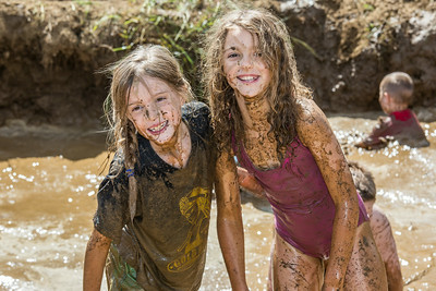 Nine-year-olds Rosie Paris, left, and Abby Conklin had a good time playing in the pit during Mud Day in the Georgeon Botanical Garden, sponsored by UAF's School of Natural Resources and Extension.  Filename: LIF-14-4212-60.jpg