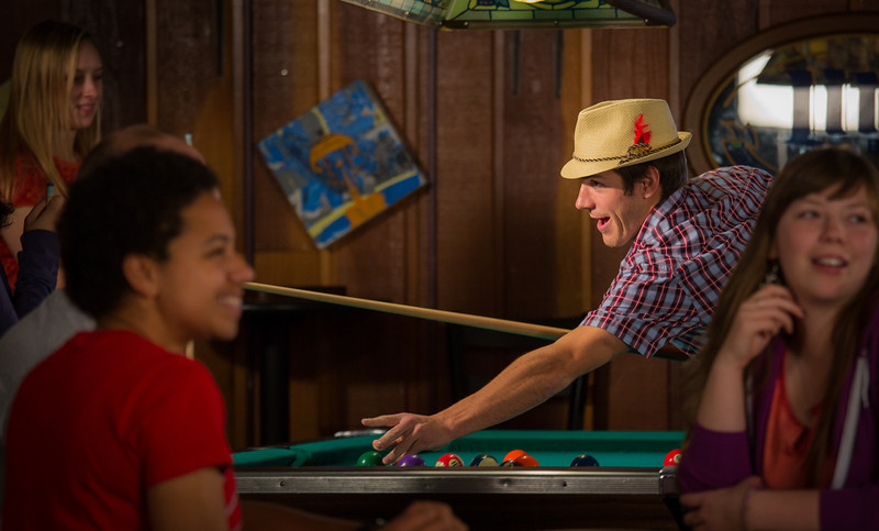 """Students unwind over a game of pool in the Wood Center Pub on the Fairbanks campus. (Note: Taken as part of commercial shoot with Nerland Agency -- use with discretion!)  <div class=""""ss-paypal-button"""">Filename: LIF-12-3563-003.jpg</div><div class=""""ss-paypal-button-end"""" style=""""""""></div>"""