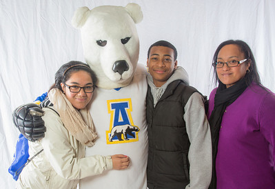Parents and prospective students pose with 'Nook, the UAF mascot, during the Spring 2013 Inside Out event hosted by UAF's department of admissions.  Filename: LIF-13-3754-91.jpg