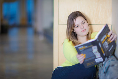 Megan Gilmore reads in the hallway of the Syun-Ichi Akasofu building on campus.  Filename: LIF-11-3242-134.jpg