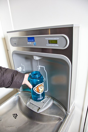 Students take advantage of a free drinking water dispenser in Wood Center aimed at reducing the number of plastic bottles that end up in the Fairbanks landfill.  Filename: LIF-11-3215-11.jpg