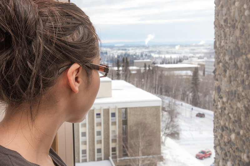 """A resident of Moore Hall checks out the view from the 8th floor on a winter afternoon.  <div class=""""ss-paypal-button"""">Filename: LIF-13-3735-183.jpg</div><div class=""""ss-paypal-button-end"""" style=""""""""></div>"""