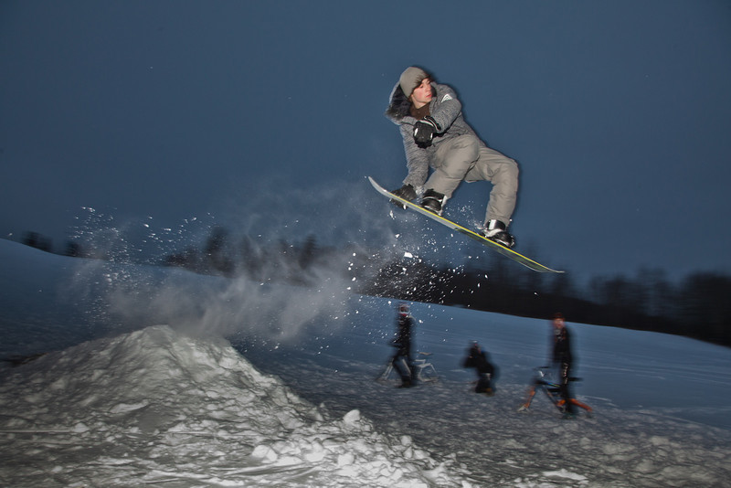 """Students take advantage of some free time during finals week to snowboard on the hill below the IAB greenhouse.  <div class=""""ss-paypal-button"""">Filename: LIF-11-3246-47.jpg</div><div class=""""ss-paypal-button-end"""" style=""""""""></div>"""