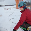 "UAF Outdoor Adventures volunteer Jason Thies turns on the water as colleagues atop the new climbing tower start the spray to form the foundation for ice climbing.  <div class=""ss-paypal-button"">Filename: LIF-11-3246-07.jpg</div><div class=""ss-paypal-button-end"" style=""""></div>"