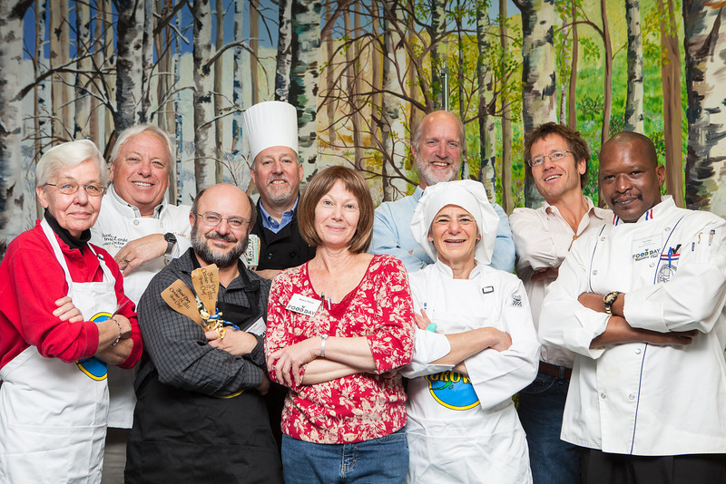 "Participants from the UAF Food Day Iron Chef cook-off competition pose for a portrait after a ""Surf vs. Turf"" battle between the School of Fisheries &amp; Ocean Sciences and the School of Natural Resources &amp; Agricultural Sciences Wednesday Oct. 17 at the Wood Center where School of Fisheries won. Photographed from the left are Carol Lewis, Chuck Lemke, Michael Castellini, Dave Sikorski, Nancy Tarnai, Frank Eagle, Jennifer Jolis, Jerry Evans and Tony Tillery.  <div class=""ss-paypal-button"">Filename: LIF-12-3590-42.jpg</div><div class=""ss-paypal-button-end"" style=""""></div>"