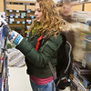 "History major Mary Tait looks for her course materials at the UAF bookstore at the beginning of the 2012 spring semester.  <div class=""ss-paypal-button"">Filename: LIF-12-3260-83.jpg</div><div class=""ss-paypal-button-end"" style=""""></div>"