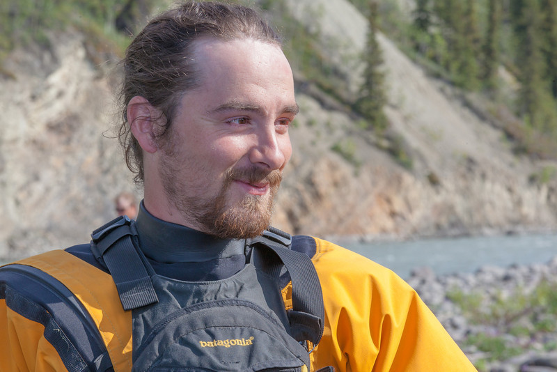 "Expedition leader Bryson DeRonde takes a break on shore during a day-long raft trip down a beautiful stretch of the Nenana River offered by UAF Outdoor Adventures.  <div class=""ss-paypal-button"">Filename: OUT-12-3492-096.jpg</div><div class=""ss-paypal-button-end"" style=""""></div>"