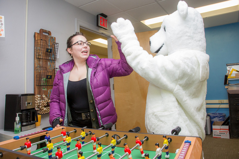 """The UAF mascot enjoys a game of foosball with colleagues in an Eielson Building office.  <div class=""""ss-paypal-button"""">Filename: LIF-14-4101-11.jpg</div><div class=""""ss-paypal-button-end"""" style=""""""""></div>"""