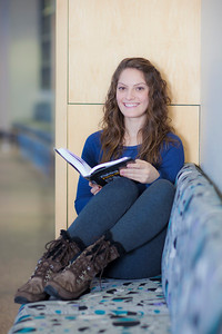 Ashley Bartolowits reads in the hallway of the Syun-Ichi Akasofu building on campus.  Filename: LIF-11-3242-088.jpg