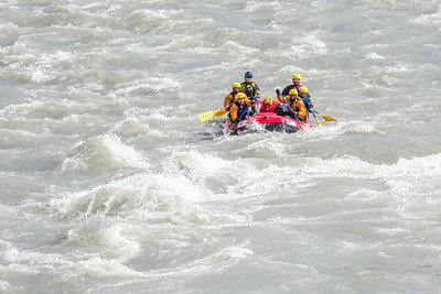 Students and staff members navigate a stretch of white water on a raft trip down the Nenana River led by UAF Outdoor Adventures in June, 2014.  Filename: OUT-14-4211-407.jpg