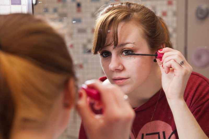 """Skarland Hall resident Hailley Myers, puts on some makeup in one of the dorm's newly re-modeled bathrooms.  <div class=""""ss-paypal-button"""">Filename: LIF-12-3322-151.jpg</div><div class=""""ss-paypal-button-end"""" style=""""""""></div>"""