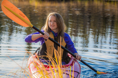 Business major Shelby Carlson enjoys a morning paddle on Ballaine Lake.  Filename: LIF-12-3562-077.jpg