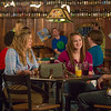 "Students unwind over a favorite beverage in the Wood Center Pub on the Fairbanks campus. (Note: Taken as part of commercial shoot with Nerland Agency -- use with discretion!)  <div class=""ss-paypal-button"">Filename: LIF-12-3563-043.jpg</div><div class=""ss-paypal-button-end"" style=""""></div>"