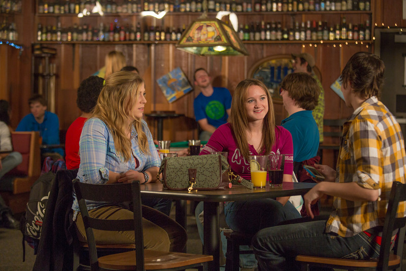 """Students unwind over a favorite beverage in the Wood Center Pub on the Fairbanks campus. (Note: Taken as part of commercial shoot with Nerland Agency -- use with discretion!)  <div class=""""ss-paypal-button"""">Filename: LIF-12-3563-043.jpg</div><div class=""""ss-paypal-button-end"""" style=""""""""></div>"""