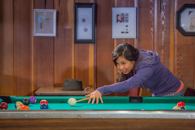 Students unwind over a game of pool in the Wood Center Pub on the Fairbanks campus. (Note: Taken as part of commercial shoot with Nerland Agency -- use with discretion!)  Filename: LIF-12-3563-027.jpg