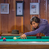 "Students unwind over a game of pool in the Wood Center Pub on the Fairbanks campus. (Note: Taken as part of commercial shoot with Nerland Agency -- use with discretion!)  <div class=""ss-paypal-button"">Filename: LIF-12-3563-027.jpg</div><div class=""ss-paypal-button-end"" style=""""></div>"