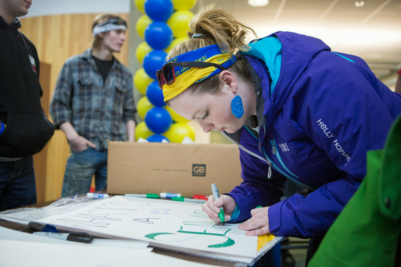 "Lauren Bradley makes a poster supporting the Alaska Nanooks Hockey team during the Keep the Cup Preparty rally at the Wood Center.  <div class=""ss-paypal-button"">Filename: LIF-14-4103-53.jpg</div><div class=""ss-paypal-button-end""></div>"