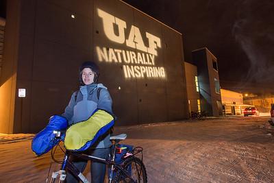 Mirjan Noetzli, an exchange student from Switzerland, arrives at the SRC on her bike to play some floorball.  Filename: LIF-12-3647-8.jpg