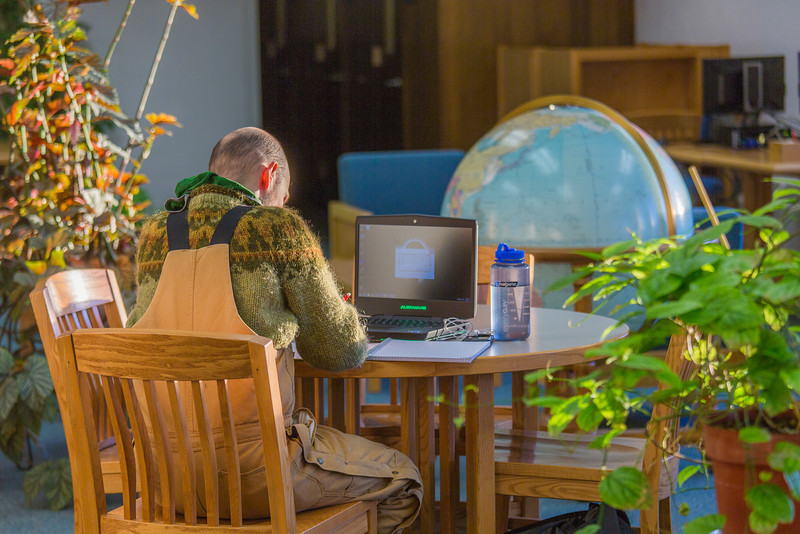 """Senior math major David Leonard catches up on some studying on the 5th floor of the Rasmuson Library.  <div class=""""ss-paypal-button"""">Filename: LIF-14-4045-9.jpg</div><div class=""""ss-paypal-button-end"""" style=""""""""></div>"""