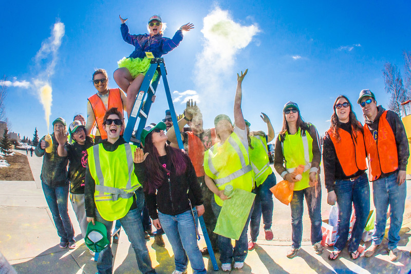 """Students enjoy getting doused with colored dye before participating in a 5-kilometer run during SpringFest on the Fairbanks campus.  <div class=""""ss-paypal-button"""">Filename: LIF-13-3805-100.jpg</div><div class=""""ss-paypal-button-end"""" style=""""""""></div>"""