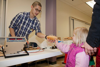 Engineering student Joseph Stribrny mans the hot dog stand for the Electrical Engineering Department during the annual Eweek open house in the Duckering Building on campus.  Filename: LIF-12-3302-15.jpg