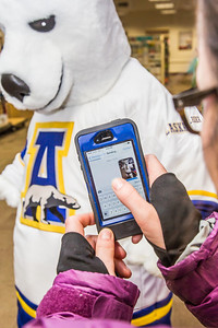 The UAF mascot tries on a new jersey in the UAF Bookstore in Constitution Hall.  Filename: LIF-14-4101-49.jpg