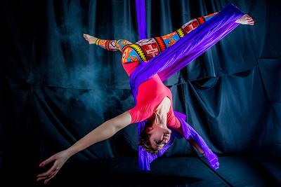 Murial Berg is an active member of the silk club at UAF, in which members perform acrobatic stunts hanging from silks.  Filename: LIF-14-4133-76.jpg