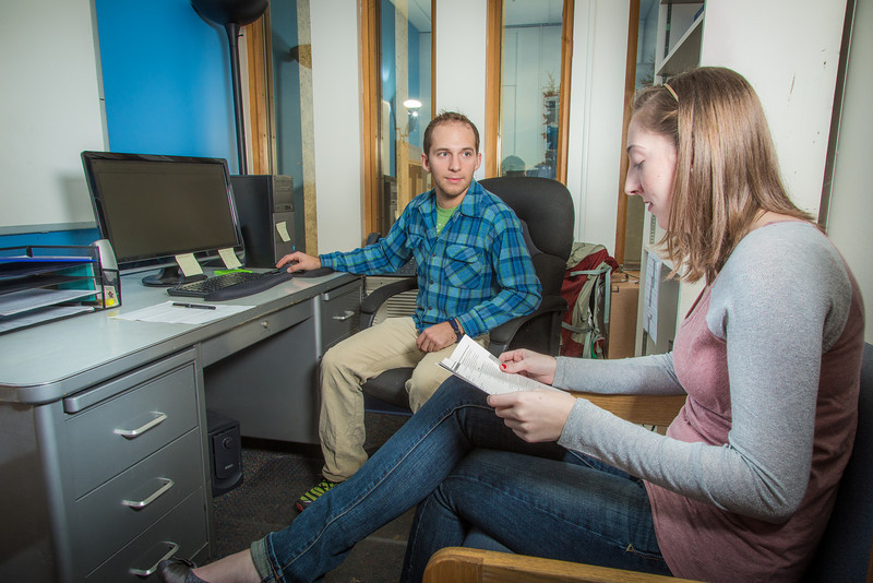 "Charlie Parr, staff member with UAF's office of Student Support Services, works with junior sociology major Megan Earle in determining her class schedule.  <div class=""ss-paypal-button"">Filename: LIF-13-3967-197.jpg</div><div class=""ss-paypal-button-end"" style=""""></div>"