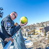 "UAF Police Chief Sean McGee drops a rotten watermelon from high atop the Gruening Building to officially launch the beginning of Springfest 2013 on the Fairbanks campus.  <div class=""ss-paypal-button"">Filename: LIF-13-3801-15.jpg</div><div class=""ss-paypal-button-end"" style=""""></div>"