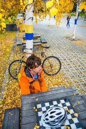 Mechanical engineering major Adam McCombs relaxes after riding his bike to campus on a fall afternoon.  Filename: LIF-12-3557-005.jpg