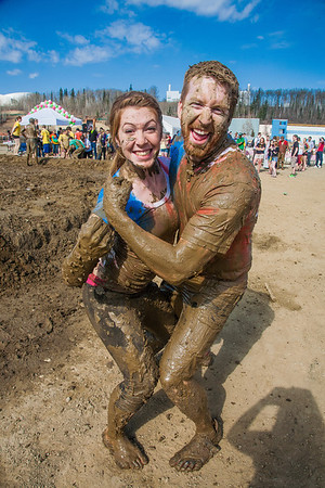 Kara La Rue (left) and Cyrus Bee (right) pose after a round of mud volleyball during Spring Fest.  Filename: LIF-12-3376-147.jpg