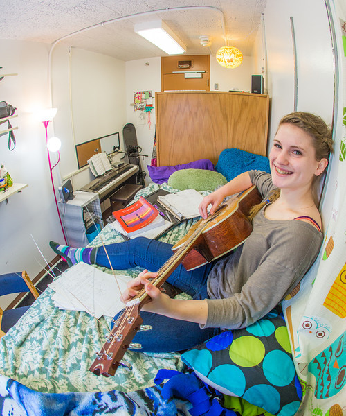 "Music major Kaylie Wiltersen practices the guitar in her Skarland Hall single room.  <div class=""ss-paypal-button"">Filename: LIF-13-3735-58.jpg</div><div class=""ss-paypal-button-end"" style=""""></div>"