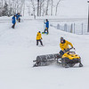 "Student employees and staff members work to groom the big jump on UAF's Terrain Park on a snowy spring afternoon.  <div class=""ss-paypal-button"">Filename: LIF-13-3721-1.jpg</div><div class=""ss-paypal-button-end"" style=""""></div>"
