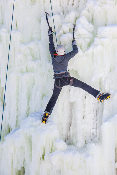 """Students take advantage of nice spring weather to try out their climbing skills on the new ice wall near the SRC.  <div class=""""ss-paypal-button"""">Filename: LIF-12-3321-074.jpg</div><div class=""""ss-paypal-button-end"""" style=""""""""></div>"""