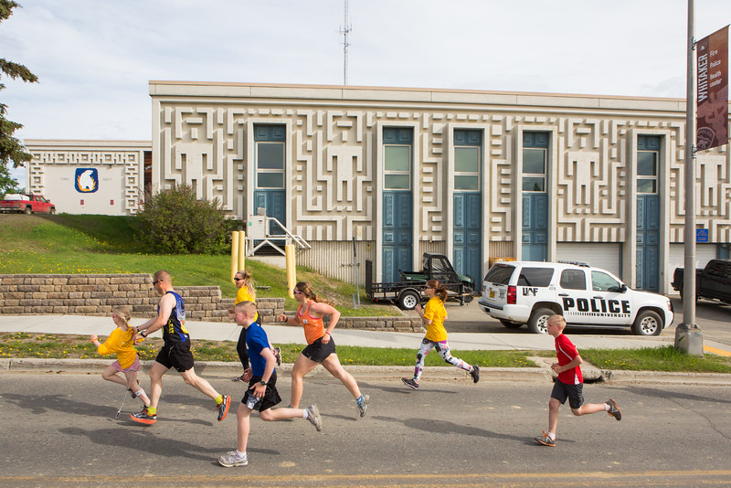 "Participants in the 5-kilometer 2016 Special Olympics Torch Run race down Yukon Drive on the Fairbanks campus May 21, 2016.  <div class=""ss-paypal-button"">Filename: LIF-16-4908-28.jpg</div><div class=""ss-paypal-button-end""></div>"
