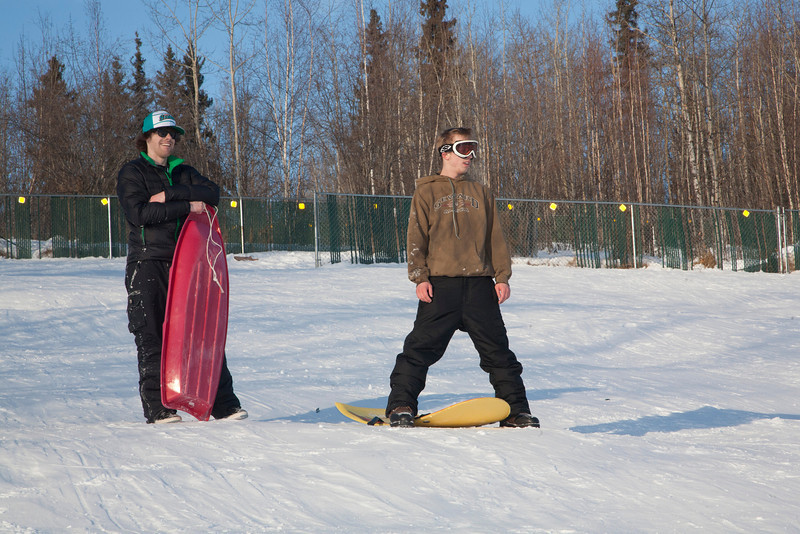 """Bryan Johnson (right) and Jimmy Donohue (left) stop sledding for a picture on the SRC Hill on a sunny day in February.  <div class=""""ss-paypal-button"""">Filename: LIF-12-3289-77.jpg</div><div class=""""ss-paypal-button-end"""" style=""""""""></div>"""
