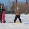 "Bryan Johnson (right) and Jimmy Donohue (left) stop sledding for a picture on the SRC Hill on a sunny day in February.  <div class=""ss-paypal-button"">Filename: LIF-12-3289-77.jpg</div><div class=""ss-paypal-button-end"" style=""""></div>"