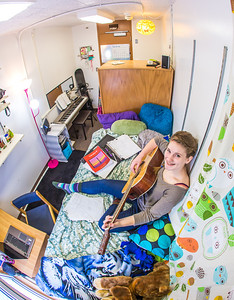 Music major Kaylie Wiltersen practices the guitar in her Skarland Hall single room.  Filename: LIF-13-3735-61.jpg