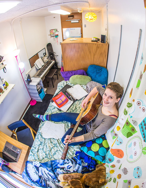 """Music major Kaylie Wiltersen practices the guitar in her Skarland Hall single room.  <div class=""""ss-paypal-button"""">Filename: LIF-13-3735-61.jpg</div><div class=""""ss-paypal-button-end"""" style=""""""""></div>"""