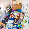 "Music major Kaylie Wiltersen practices the guitar in her Skarland Hall single room.  <div class=""ss-paypal-button"">Filename: LIF-13-3735-61.jpg</div><div class=""ss-paypal-button-end"" style=""""></div>"