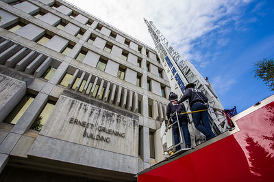 Student firefighters with the University Fire Department conduct a drill using the big ladder truck on the Gruening Building Wednesday afternoon.  Filename: LIF-12-3475-05.jpg
