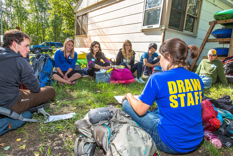 """Students go over an outdoor gear checklist before leaving campus for a wilderness experience lead by UAF's Outdoor Adventures program before the beginning of the fall 2013 semester.  <div class=""""ss-paypal-button"""">Filename: OUT-13-3917-04.jpg</div><div class=""""ss-paypal-button-end"""" style=""""""""></div>"""