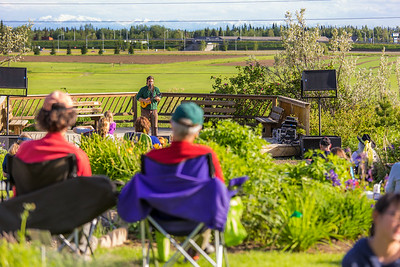 Local musician Ukulele Russ entertained a nice crowd during UAF Summer Session's free Music in the Garden concert series June 12.  Filename: LIF-14-4209-86.jpg