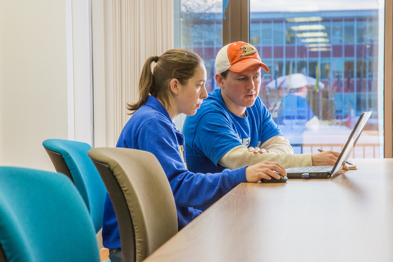 """Amy and Ryan Feldmeier, both majoring in accounting through UAF's School of Management, search their laptop between classes in the Rasmuson Library.  <div class=""""ss-paypal-button"""">Filename: LIF-14-4045-205.jpg</div><div class=""""ss-paypal-button-end"""" style=""""""""></div>"""
