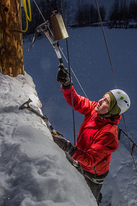 Engineering major Jesse Frey rings the cowbell after a climb up the ice wall during a fun competition on March 1.  Filename: LIF-13-3748-111.jpg