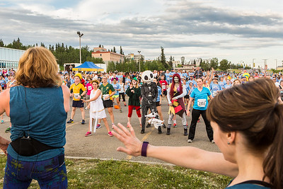 Participants in the 2016 Midnight Sun Run dress up in costume for the popular event near the summer solstice.  Filename: LIF-16-4918-75.jpg