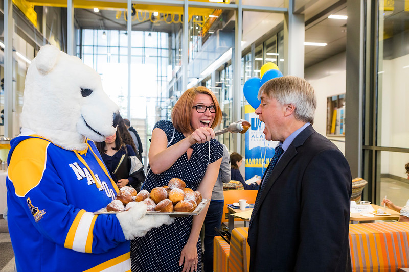 "UAF Admissions Director Mary Kreta strikes a pose with School of Management Dean Mark Herrmann is ready during the 2018 Summer Inside Out Donuts with Deans event at the Engineering Learning and Innovation Facility.  <div class=""ss-paypal-button"">Filename: LIF-18-5826-107.jpg</div><div class=""ss-paypal-button-end""></div>"