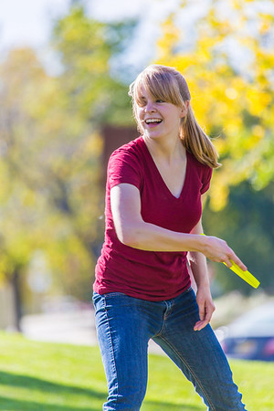 Music major Ingrid Dye takes time between classes to play with a frisbee on a beautiful September afternoon on the Fairbanks campus.  Filename: LIF-13-3934-25.jpg