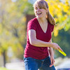 "Music major Ingrid Dye takes time between classes to play with a frisbee on a beautiful September afternoon on the Fairbanks campus.  <div class=""ss-paypal-button"">Filename: LIF-13-3934-25.jpg</div><div class=""ss-paypal-button-end"" style=""""></div>"